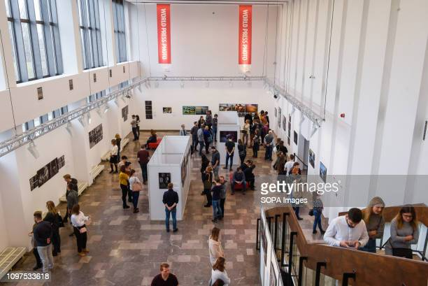 People seen attending the World Press Photo exhibition at the Nowa Huta Cultural Center
