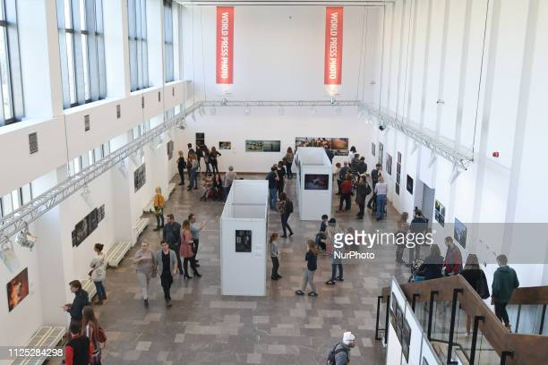 People seen attending the WORLD PRESS PHOTO inside the NCK in Nowa Huta The best press photos of the year 2018 can be seen during to the exhibition...