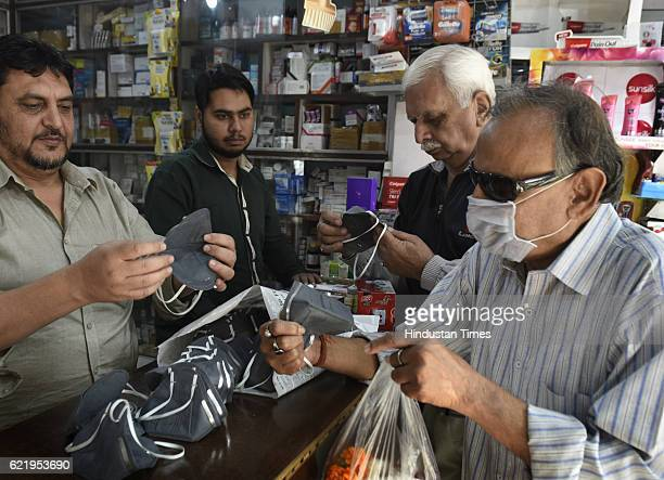 People seen buying Air Pollution Mask to protect themselves from bad air condition in city in Mayur Vihar on November 9 2016 in New Delhi India In a...