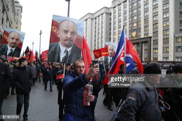 MOSCOW RUSSIA People seen carrying the portrait of Vladimir Lenin and the soviet union flag during the march Thousands marched to Revolution Square...
