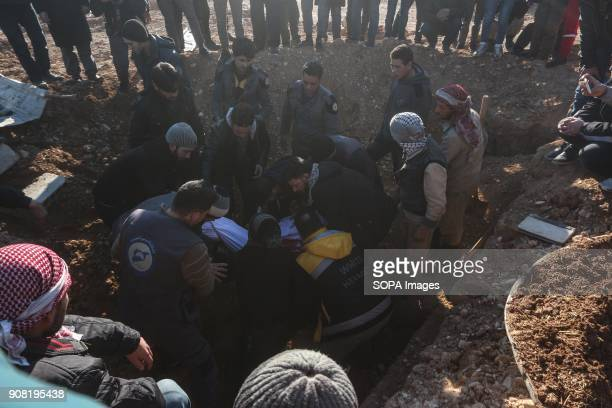 People seen digging a huge hole in the soil to bury 11 bodies The Regime forces shelled a residential area of Douma and killed 11 people including a...