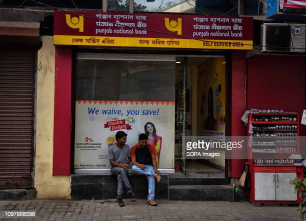 People seen gossiping in front of the Punjab National Bank self service corner at Park street in Kolkata