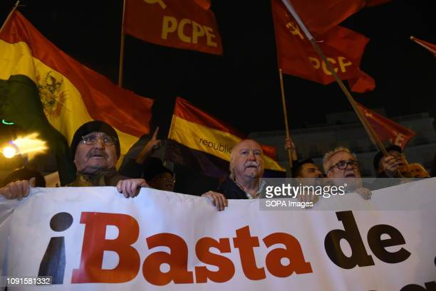 People seen holding a huge banner and flags during the protest Around 150 people gathered at Puerta del Sol in Madrid to protest showing support to...
