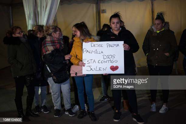 People seen holding a placard in support of Julen Rosello during a vigil for the 2 year old boy who fell into a well more than 100 meters deep as he...