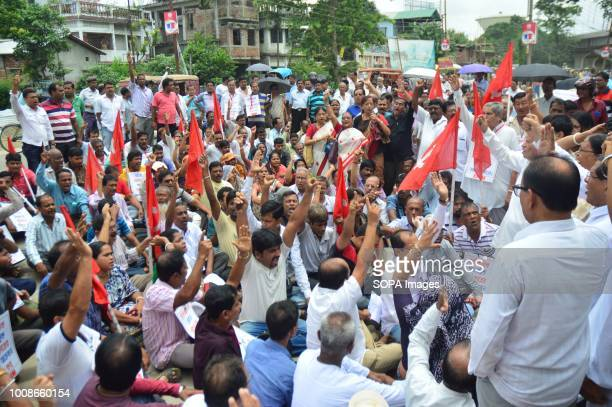 People seen holding flags during the protest The Communist Party of India workers and leaders demonstrated in front of police headquarters in...