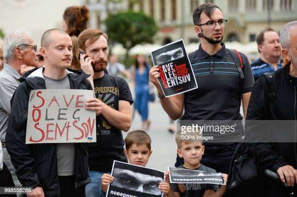 People seen holding posters during the protest Protest demanding the release of the Ukrainian filmmaker and writer Oleg Sentsov at the Main Square in...