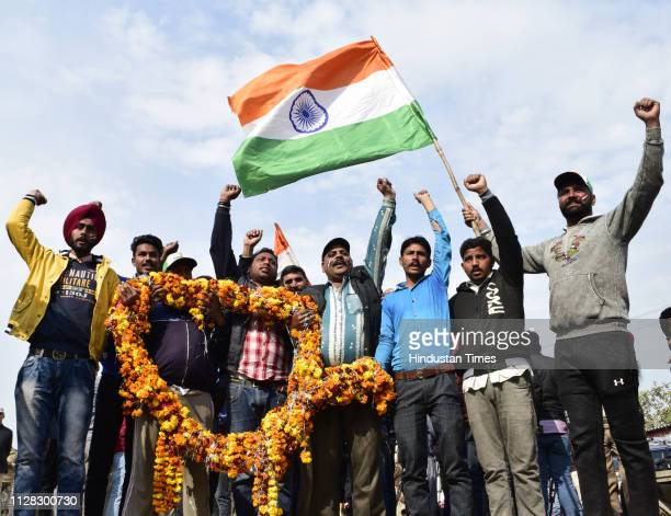 People seen in jubilate mood with a Tricolour as they wait for the arrival of IAF pilot Wing Commander Abhinandan Varthaman at AttariWagha border on...