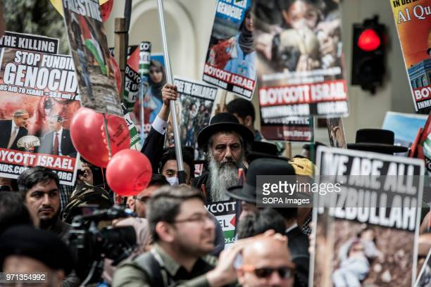 People seen in the propalestine demonstration Hundreds of antiIsrael protesters marched through the streets on the annual Al Quds Day Started by the...