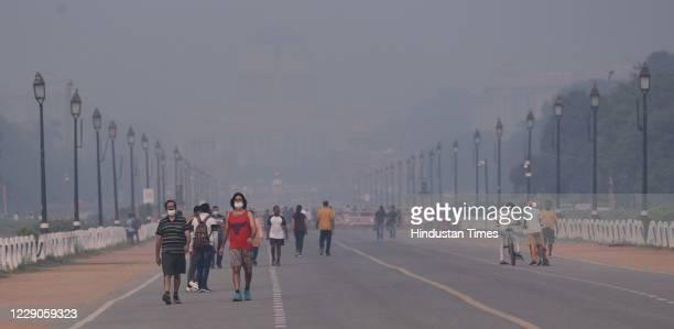 People seen jogging amid dense smog at Rajpath, on October 13, 2020 in New Delhi, India.