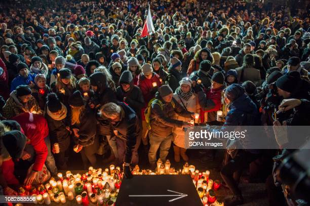 WARSW WARSAW MAZOWIECKIE POLAND People seen lightning candles in memory of the mayor Pawel Adamowicz Pawel Adamowicz the mayor of the Polish city of...