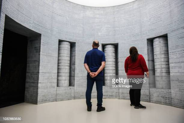 People seen observing inscriptions during the event Exhibition at Oskar Schindler's Enamel Factory museum it is primarily a story about Krakow and...