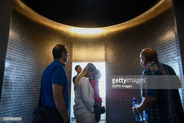 People seen observing Schindler list installation during the exhibition Exhibition at Oskar Schindler's Enamel Factory museum it is primarily a story...
