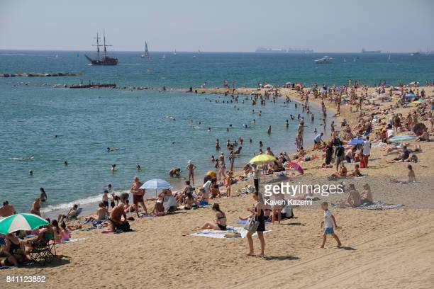 People seen on a hot summer day in busy Barceloneta Beach on July 12 2017 in Barcelona Spain