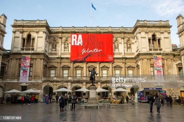 People seen outside The Royal Academy of Art Gallery. London is set to move to high alert level on Wednesday 16th December.