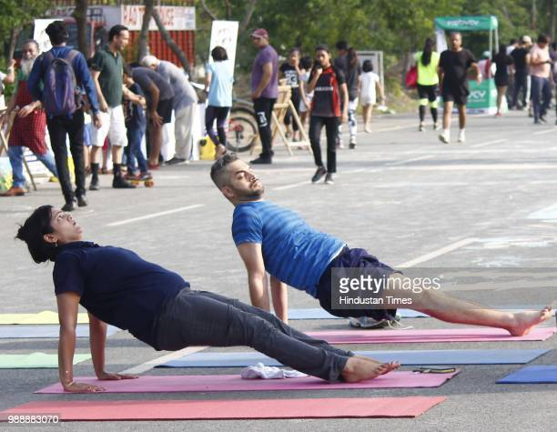 People seen performing yoga during a Raahgiri Day an event organised by MCG at Sector 55 Golf Course Road in Gurugram India on Sunday July 01 2018...