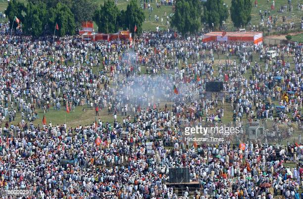 People seen rushing after six serial bomb blasts took place at the venue of Narendra Modi's Hunkar rally near Gandhi Maidan on October 27 2013 in...