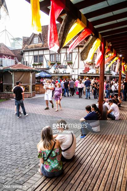 People seen seating at the porch during the festival Oktoberfest 2018 is a Germany beer festival in Blumenau a Brazilian city founded by German...