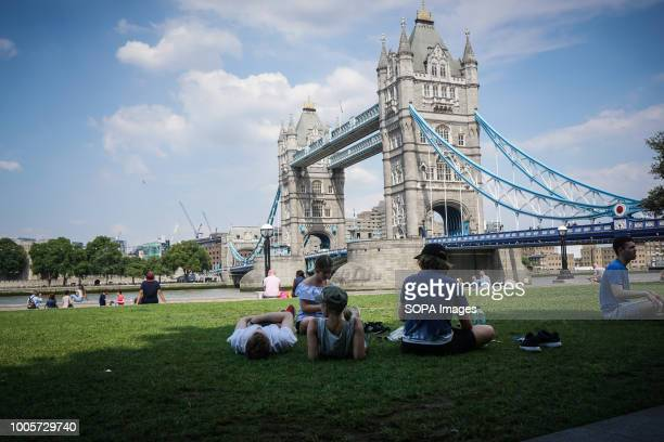People seen sitting out on a hot day in London High temperatures in the United Kingdom will continue and the temperatures will be 35 degrees Celsius...