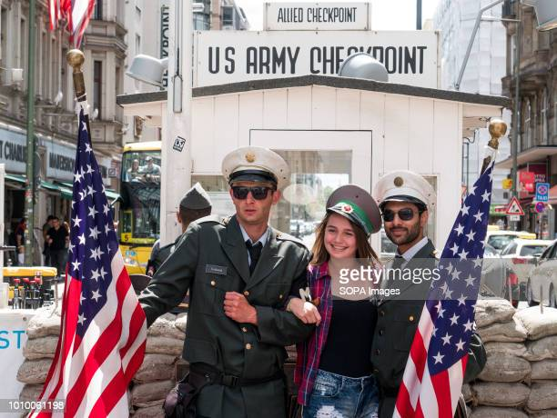 People seen taking pics at the American checkpoint Charlie with uniform guys one of the 3 crossing points between East and West Berlin The Berlin...