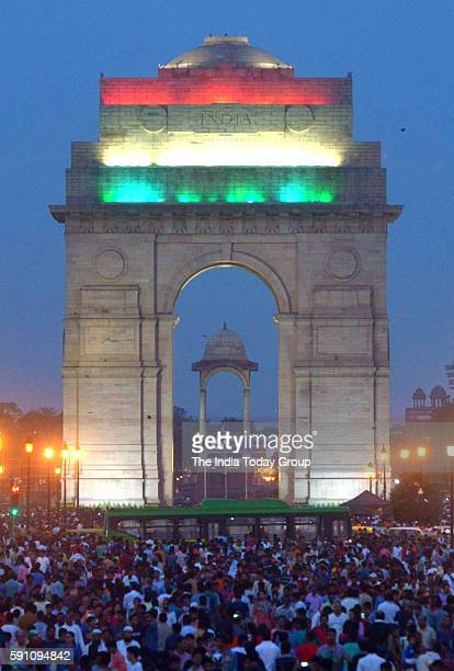 People seen thronging at Rajpath as the TriColour illumination at India Gate for Independence Day Celebrations in New Delhi