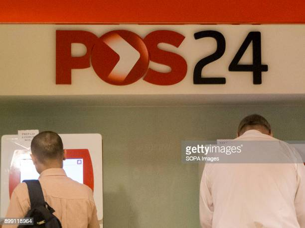 People seen using a Malaysian post machine called POS24 Malaysia economy is the third most sustain in Southeast Asia and it is the 35th largest...