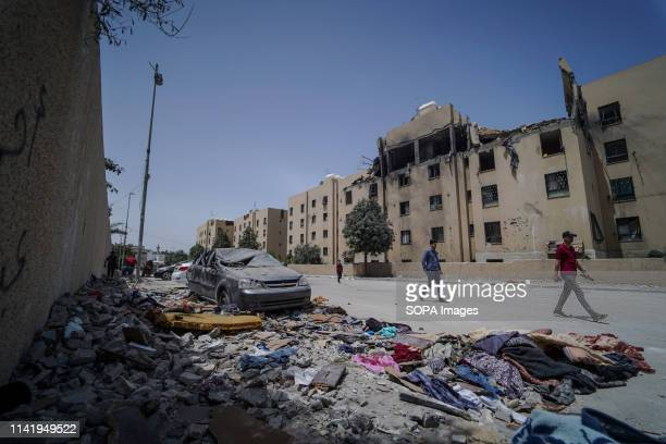 People seen walking next to the damaged house of the deceased during the funeral of Maria alGazali a fourmonthold Palestinian baby who was martyred...