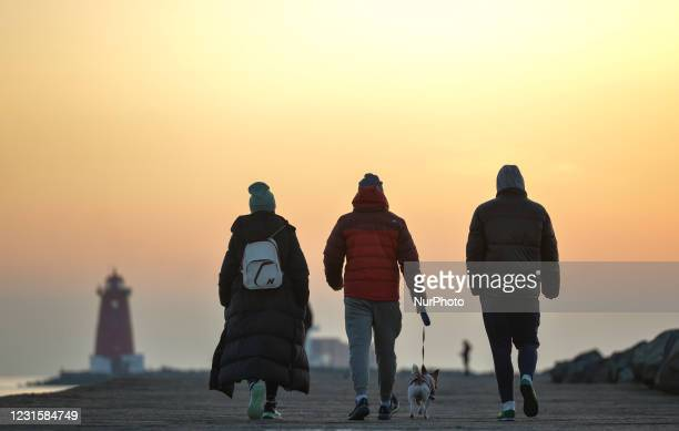 People seen walking on the Great South Wall in Dublin, during Level 5 Covid-19 lockdown. On Sunday, 7 March in Dublin, Ireland.