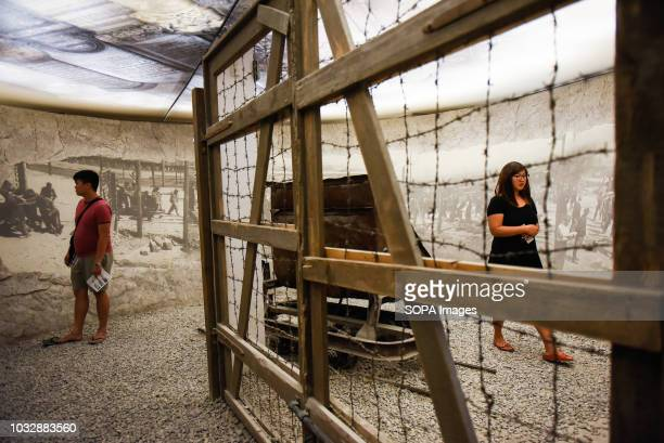 People seen walking through a Kraków Paszów concentration camp installation during the exhibition Exhibition at Oskar Schindler's Enamel Factory...