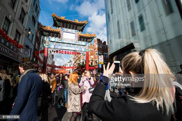 People seen walking through the Chinatown streets during the Chinese New Year celebration Chinese London community celebrate the Year of the Dog with...
