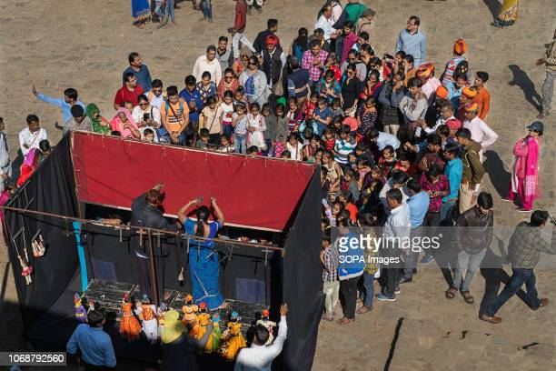FORT UDAIPUR RAJASTHAN INDIA People seen watching a puppet show at the Kumbhalgarh Festival in the Kumbhalgarh Fort Kumbhalgah is a Classic Dance...