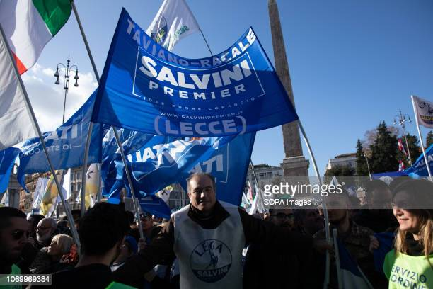People seen waving flags and banner during the event The league party held a political rally with the phrase Italy lift your head at Piazza del...