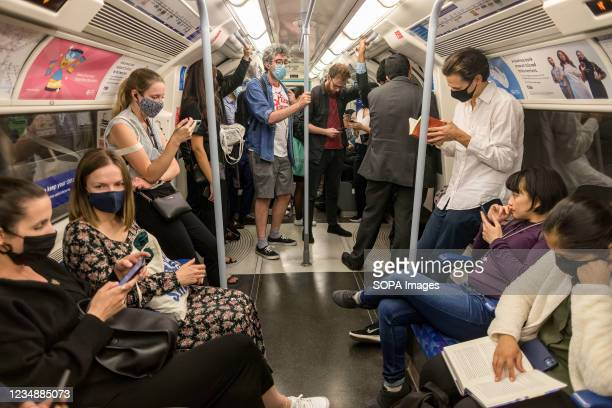 People seen wearing facemasks in the London underground.