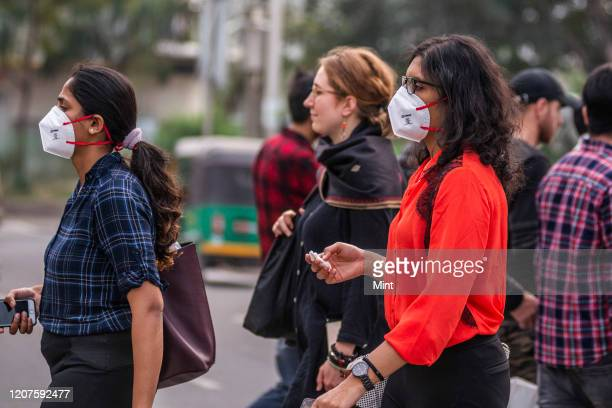 People seen wearing masks at Connaught Place, on March 4, 2020 in New Delhi, India. The virus has spread to more than 150 countries and 13 states in...