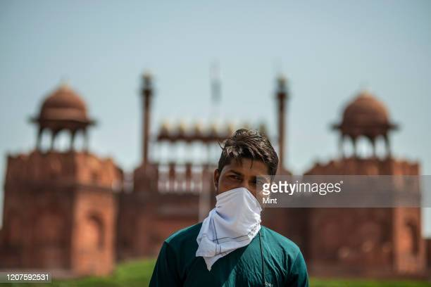 People seen wearing masks at Red fort, on March 13, 2020 in New Delhi, India. The virus has spread to more than 150 countries and 13 states in India,...