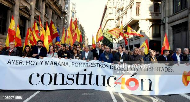 People seen with a huge banner while participating in a march during the event Two thousand people celebrated the 40th Anniversary of the Spanish...