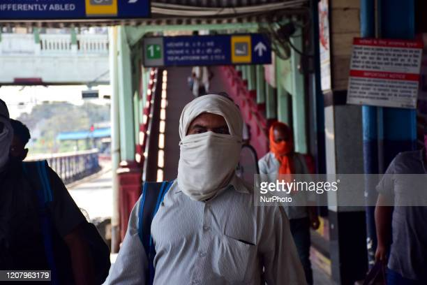 People seen with their faces covered with cloth scarf during a One day nationwide Janata curfew imposed as a preventive measure against the COVID-19...