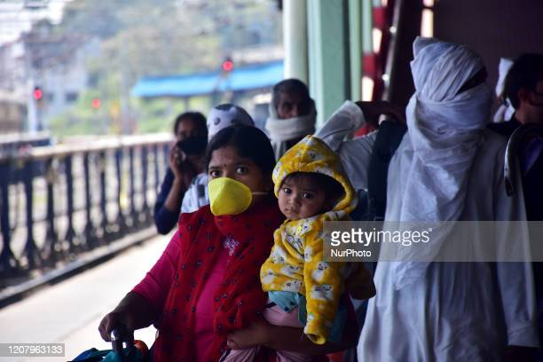People seen with their faces covered with protective masks during a One day nationwide Janata curfew imposed as a preventive measure against the...