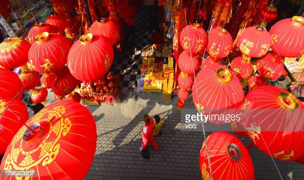 People select spring festival knots, lanterns, scrolls and other decorations before Chinese new year, on January 24, 2021 in Wuhan, Hubei Province of...
