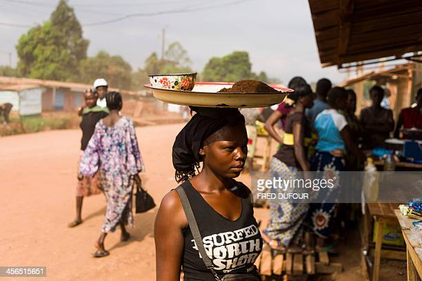 People sell food and goods at a market in the centre of Bangui on December 14 a week after France sent troops into the Central African Republic to...