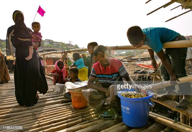 People sell goods on a bridge in a Rohingya refugee camp on January 23, 2020 in Cox's Bazar, Bangladesh. On Thursday, the International Court of...