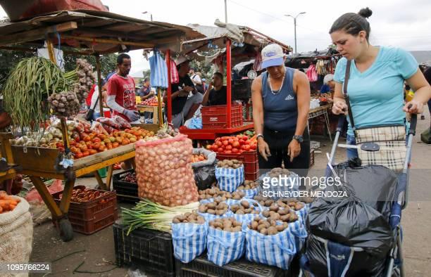 People sell groceries in La Parada neighborhood in Cucuta Colombia near the Simon Bolivar International Bridge on the border with Tachira Venezuela...