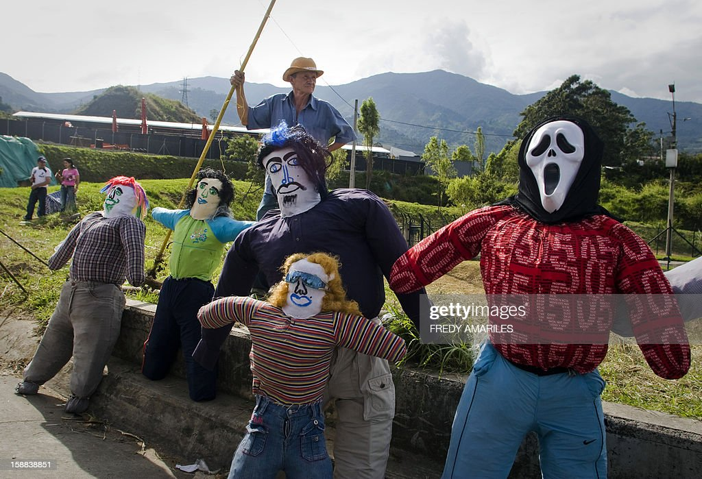 People sell 'Old Year' dolls on the outskirts of Medellin, Colombia, on December 31, 2012. It is a popular tradition in Colombia to burn 'Old Year' dolls on the last night of the year. AFP PHOTO/Fredy AMARILES