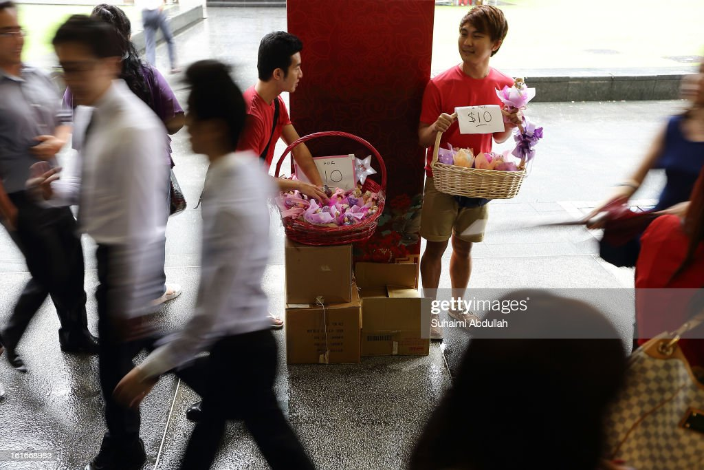 People sell Valentine's Day gift items at Raffles Place on 14 February, 2013 in Singapore. Valentine's Day is a time to celebrate love, romance and friendship and is celebrated worldwide annually in different ways on February 14.