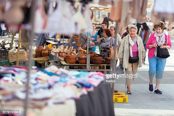 People selling and shopping at city market in Sineu Mallorca