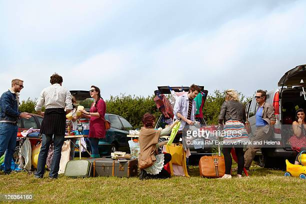 People selling things from car trunks