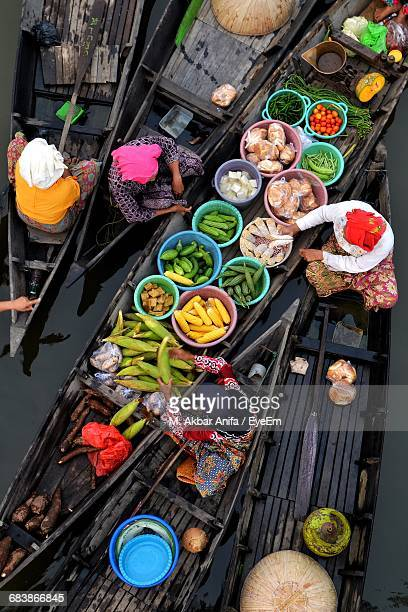 people selling vegetables on boat - floating market stock photos and pictures