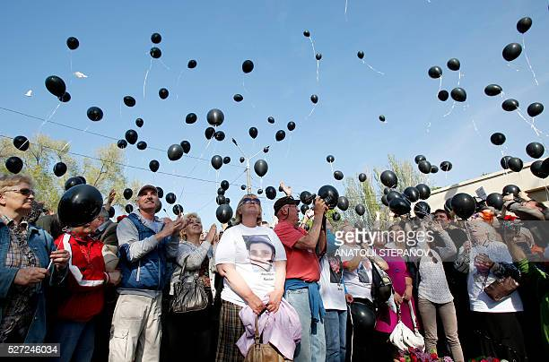 People send up black balloons during a proRussian meeting next to Kulikove Pole Square in Odessa southern Ukraine on May 2 2016 in memory of those...