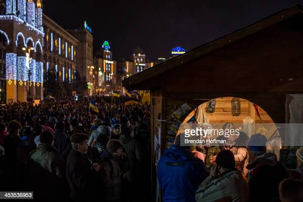 People serve tea to antigovernment protesters from a small booth in Independence Square on December 4 2013 in Kiev Ukraine Thousands of people have...