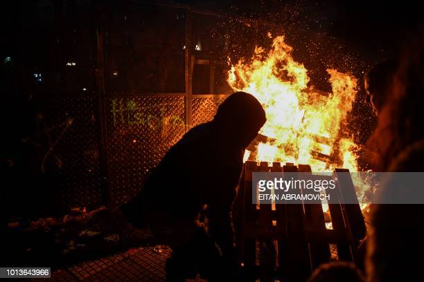 TOPSHOT People set a fire outside the National Congress in Buenos Aires on August 9 after senators rejected the bill to legalize abortion Argentine...