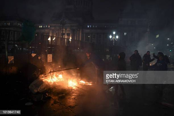 People set a fire outside the National Congress in Buenos Aireson August 9 after senators rejected the bill to legalize abortion Argentine senators...